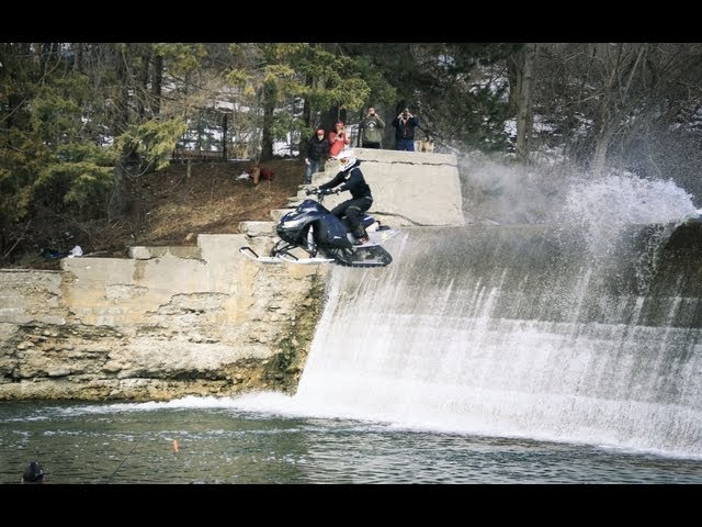 Snowmobile Jump Off 15 Foot Dam!