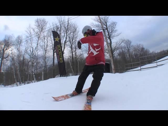 Snowboarder skis a sawed snowboard!