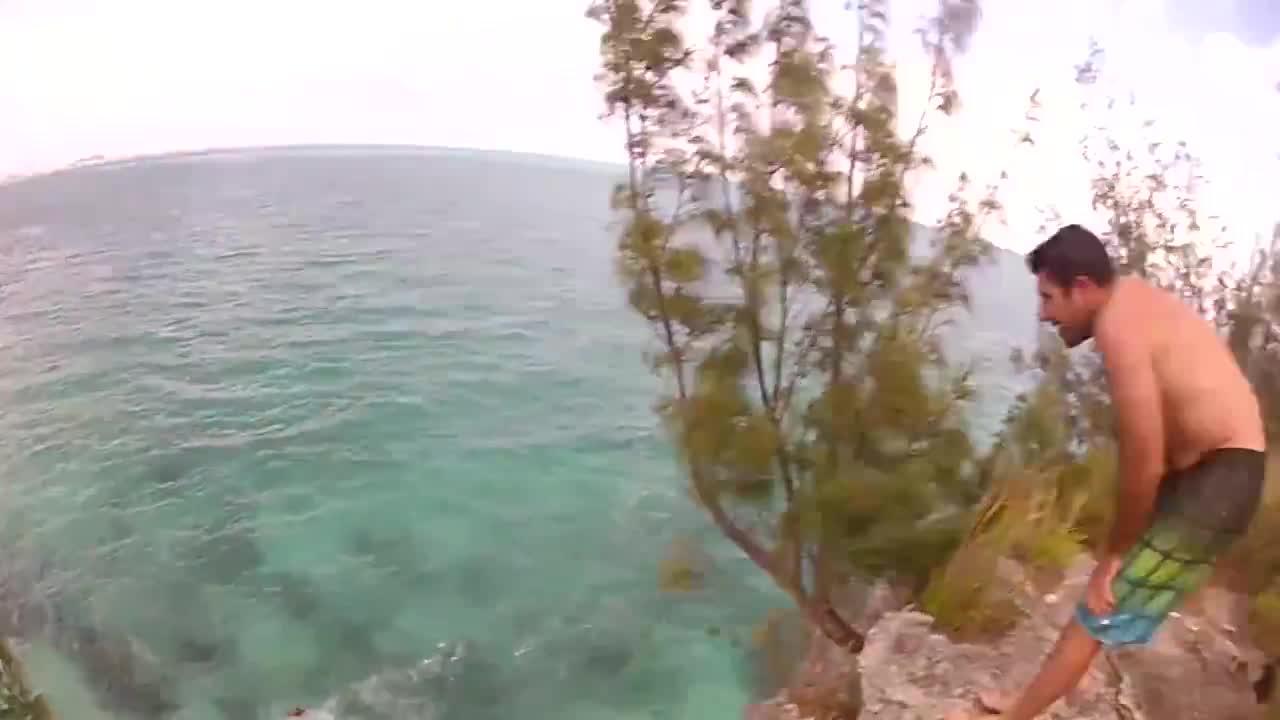 Cliffjumper Almost Lands On Windsurfer!