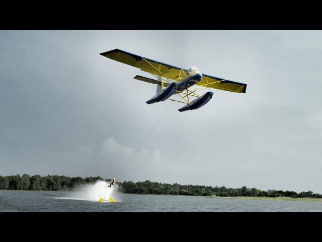 Barefoot Waterskiing behind Plane