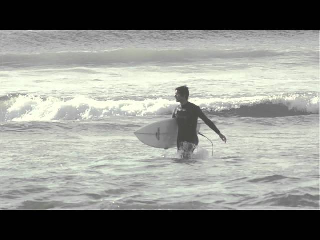 Some surfers having fun in a cold day!!!