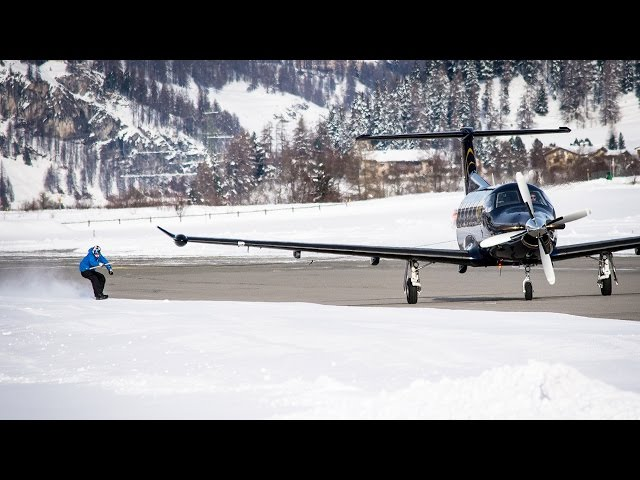 Snowboarder towed by a plane