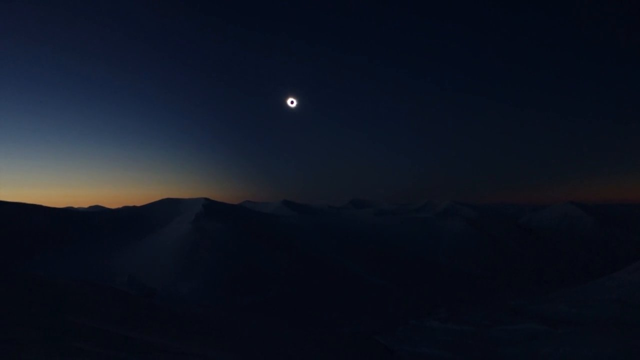 Solar Eclipse Snowboarding in Svalbard
