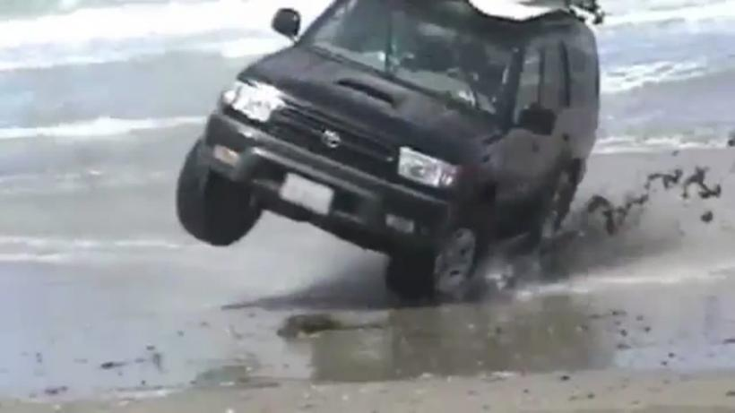 How Not To Park An SUV At The Beach