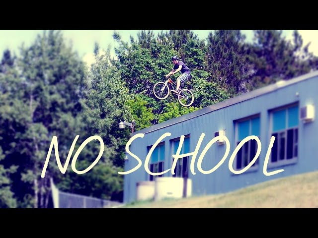 GUY JUMPS OFF SCHOOL ROOF WITH A BIKE.....