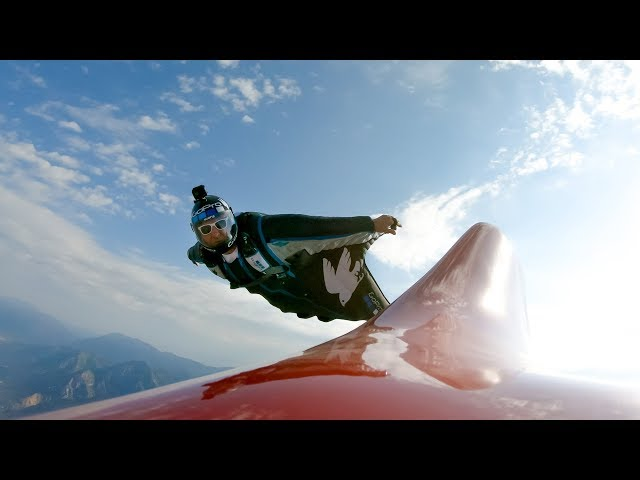 Wingsuit Flight While Holding Plane